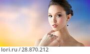 Купить «beautiful woman with earring, ring and pendant», фото № 28870212, снято 9 апреля 2016 г. (c) Syda Productions / Фотобанк Лори