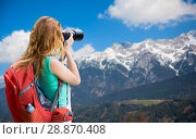 Купить «woman with backpack and camera over alps mountains», фото № 28870408, снято 25 июля 2015 г. (c) Syda Productions / Фотобанк Лори