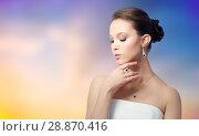 Купить «beautiful asian woman with earring and pendant», фото № 28870416, снято 9 апреля 2016 г. (c) Syda Productions / Фотобанк Лори