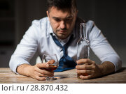 Купить «drunk man drinking alcohol at table at night», фото № 28870432, снято 24 ноября 2017 г. (c) Syda Productions / Фотобанк Лори
