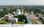 Купить «Flight of the camera over Saint Sophia orthodox cathedral and church of Resurrection of Jesus in a sunny summer day in Vologda Kremlin», видеоролик № 28870712, снято 30 июля 2018 г. (c) Mikhail Starodubov / Фотобанк Лори