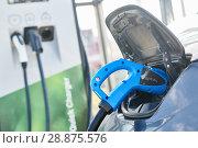 Купить «electric car charging. Ecological automobile», фото № 28875576, снято 6 июля 2018 г. (c) Дмитрий Калиновский / Фотобанк Лори