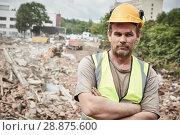 Купить «Demolition construction work. Worker at building site», фото № 28875600, снято 24 июля 2018 г. (c) Дмитрий Калиновский / Фотобанк Лори