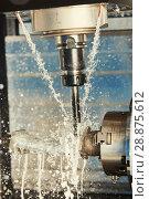 Купить «Milling metalworking process. Industrial CNC metal machining by vertical mill. Coolant and lubrication», фото № 28875612, снято 15 мая 2018 г. (c) Дмитрий Калиновский / Фотобанк Лори