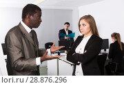 Купить «Unhappy woman manager listening angry man boss», фото № 28876296, снято 24 марта 2018 г. (c) Яков Филимонов / Фотобанк Лори
