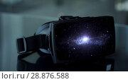 Купить «vr headset with virtual space animation», видеоролик № 28876588, снято 22 февраля 2019 г. (c) Syda Productions / Фотобанк Лори