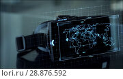 Купить «vr headset with coding and world map on screen», видеоролик № 28876592, снято 24 марта 2019 г. (c) Syda Productions / Фотобанк Лори