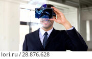 Купить «businessman in vr headset with earth projection», видеоролик № 28876628, снято 22 мая 2019 г. (c) Syda Productions / Фотобанк Лори