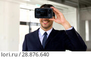 Купить «businessman with vr headset and virtual screen», видеоролик № 28876640, снято 20 июня 2019 г. (c) Syda Productions / Фотобанк Лори