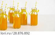 Купить «juice or lemonade in glass bottles with straws», видеоролик № 28876892, снято 13 июля 2018 г. (c) Syda Productions / Фотобанк Лори