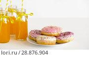 Купить «donuts and lemonade or juice in glass bottles», видеоролик № 28876904, снято 13 июля 2018 г. (c) Syda Productions / Фотобанк Лори