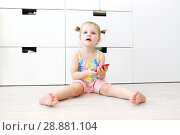 Купить «Cute little 2 years toddler girl with mobile phone», фото № 28881104, снято 23 июля 2018 г. (c) ivolodina / Фотобанк Лори