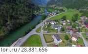 Купить «Деревня Hildal в долине, расположенная вдоль реки у трассы Rv13. Южная Норвегия», видеоролик № 28881656, снято 13 июля 2018 г. (c) Кекяляйнен Андрей / Фотобанк Лори