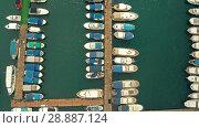 Купить «Aerial view of docked boats», видеоролик № 28887124, снято 18 июля 2018 г. (c) Илья Шаматура / Фотобанк Лори