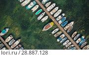 Купить «Boats on a dock aerial view», видеоролик № 28887128, снято 20 июля 2018 г. (c) Илья Шаматура / Фотобанк Лори