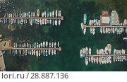 Купить «Aerial view boats on a dock», видеоролик № 28887136, снято 20 июля 2018 г. (c) Илья Шаматура / Фотобанк Лори