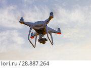 Купить «Professional drone quad copter with digital camera at sunset ready to fly for surveillance. close-up of Rotor UAV. four blade propeller drone. silhouette copter on beautiful sunset.», фото № 28887264, снято 22 июля 2018 г. (c) Алексей Ширманов / Фотобанк Лори
