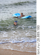 Купить «Two children on an bathe in the sea», фото № 28889180, снято 16 июля 2018 г. (c) Типляшина Евгения / Фотобанк Лори