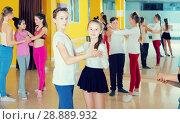Tweens training slow foxtrot in dance studio. Стоковое фото, фотограф Яков Филимонов / Фотобанк Лори