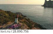 Купить «Yoga at sunset aerial view», видеоролик № 28890756, снято 16 июля 2018 г. (c) Илья Шаматура / Фотобанк Лори