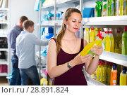 Купить «woman choosing detergent at a household goods in the store», фото № 28891824, снято 13 апреля 2017 г. (c) Яков Филимонов / Фотобанк Лори