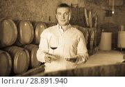 Купить «man with glass of wine in winery cellar», фото № 28891940, снято 22 сентября 2016 г. (c) Яков Филимонов / Фотобанк Лори