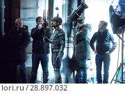Купить «Film crew and stuntmen prepare for the filming of the upcoming movie 'Avengers: Infinity War' on the Royal Mile in Edinburgh Featuring: Stuntman Where...», фото № 28897032, снято 31 марта 2017 г. (c) age Fotostock / Фотобанк Лори