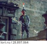 Купить «Film crew and stuntmen prepare for the filming of the upcoming movie 'Avengers: Infinity War' on the Royal Mile in Edinburgh Featuring: Stuntman Where...», фото № 28897064, снято 31 марта 2017 г. (c) age Fotostock / Фотобанк Лори
