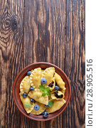 blueberry dumplings, pierogi, vareniki in a bowl. Стоковое фото, фотограф Oksana Zh / Фотобанк Лори