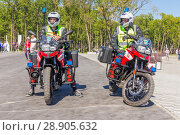 Купить «Russia, Samara, June 2018: firefighters on special motorcycles equipped for fire fighting at the stadium of Samar arena in the match day of Serbia Costa Rica.», фото № 28905632, снято 17 июня 2018 г. (c) Акиньшин Владимир / Фотобанк Лори