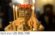 Купить «Believers in the church. Russian Orthodox Church», видеоролик № 28906748, снято 7 августа 2018 г. (c) Mikhail Erguine / Фотобанк Лори
