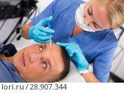 Купить «Female doctor is doing injection to patient in skin of face», фото № 28907344, снято 17 августа 2018 г. (c) Яков Филимонов / Фотобанк Лори