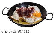 Купить «Plate with fried eggs with Jabugo ham at white background», фото № 28907612, снято 7 марта 2018 г. (c) Яков Филимонов / Фотобанк Лори