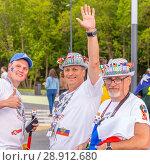 Купить «Russia, Samara, June 2018: benevolent mature football fans in original hats with national flags at the World Cup.», фото № 28912680, снято 21 июня 2018 г. (c) Акиньшин Владимир / Фотобанк Лори