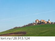 Купить «Pasture and castle of Chateau de Chateauneuf», фото № 28913124, снято 17 декабря 2016 г. (c) Сергей Новиков / Фотобанк Лори