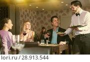 Купить «waiter bringing ordered dishes to guests», фото № 28913544, снято 8 января 2018 г. (c) Яков Филимонов / Фотобанк Лори