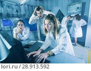 Купить «Adults trying to get out of escape room», фото № 28913592, снято 6 июля 2017 г. (c) Яков Филимонов / Фотобанк Лори