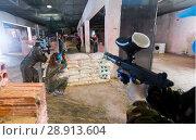 Купить «Gamers are targeting in enemy behind barricades», фото № 28913604, снято 10 июля 2017 г. (c) Яков Филимонов / Фотобанк Лори