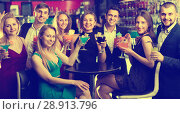 Купить «Colleagues dancing on corporate party with cocktails in hands», фото № 28913796, снято 20 апреля 2017 г. (c) Яков Филимонов / Фотобанк Лори