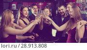Купить «Glad colleagues dancing with cocktails», фото № 28913808, снято 20 апреля 2017 г. (c) Яков Филимонов / Фотобанк Лори