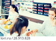 Купить «woman getting manicure in beauty salon and talking on phone», фото № 28913828, снято 28 апреля 2017 г. (c) Яков Филимонов / Фотобанк Лори