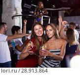 Купить «Females friends dancing in club», фото № 28913864, снято 28 августа 2017 г. (c) Яков Филимонов / Фотобанк Лори