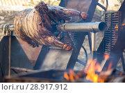 Купить «Whole bull carcass on spit», фото № 28917912, снято 24 марта 2019 г. (c) Яков Филимонов / Фотобанк Лори
