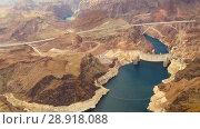 Купить «aerial view of hoover dam at grand canyon», видеоролик № 28918088, снято 21 июля 2018 г. (c) Syda Productions / Фотобанк Лори