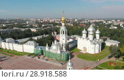 Купить «Flight of the camera over Saint Sophia orthodox cathedral and church of Resurrection of Jesus in a sunny summer day in Vologda Kremlin», видеоролик № 28918588, снято 8 августа 2018 г. (c) Mikhail Starodubov / Фотобанк Лори