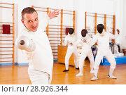 Купить «man fencer practicing effective fencing techniques», фото № 28926344, снято 11 июля 2018 г. (c) Яков Филимонов / Фотобанк Лори