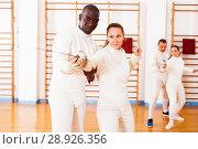 Купить «fencer practicing movements with african american trainer», фото № 28926356, снято 11 июля 2018 г. (c) Яков Филимонов / Фотобанк Лори