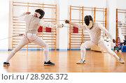Купить «Fencers exercising techniques in battle», фото № 28926372, снято 11 июля 2018 г. (c) Яков Филимонов / Фотобанк Лори