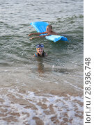 Купить «Two children on an bathe in the sea», фото № 28936748, снято 16 июля 2018 г. (c) Типляшина Евгения / Фотобанк Лори