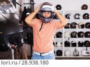 Купить «Man trying up moto helmet», фото № 28938180, снято 1 сентября 2017 г. (c) Яков Филимонов / Фотобанк Лори